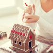 Close up of woman making gingerbread house at home — Stock Photo #60140883