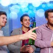 Group of male friends with beer in nightclub — Stock Photo #60142037
