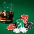 Close up of casino chips and whisky glass on table — Stock Photo #60142119