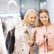 Happy young women with shopping bags in mall — Stock Photo #60142437