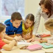 Group of school kids writing test in classroom — Stock Photo #60142501