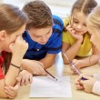 Group of students talking and writing at school — Stock Photo #60142523