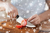 Close up of man cutting vegetables with knife — Stock Photo