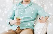 Man with beer and remote control at home — Stock Photo