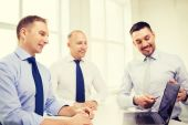 Smiling businessmen having discussion in office — Stock Photo