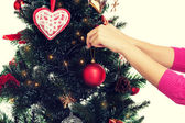Close up of woman with christmas tree decoration — Foto de Stock