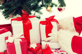 Close up of santa claus with presents — Stock Photo