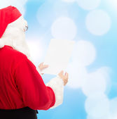 Man in costume of santa claus with letter — Stockfoto