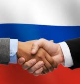 Close up of handshake over russian flag — Stock Photo