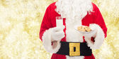 Santa claus with glass of milk and cookies — Foto de Stock