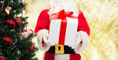 Man in costume of santa claus with gift box — Foto Stock