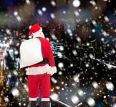 Man in costume of santa claus with bag — Stockfoto