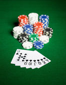 Close up of casino chips and playing cards — Stockfoto