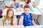 Group of school kids showing thumbs up — Foto de Stock