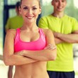 Smiling man and woman in gym — Stock Photo #60164359