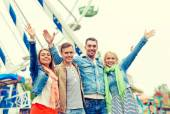 Group of smiling friends waving hands — Stock Photo