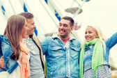 Group of smiling friends in amusement park — Foto Stock