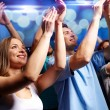 Smiling friends at concert in club — Stock Photo #60171849