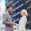 Smiling businessmen standing over office building — Stock Photo #60171963