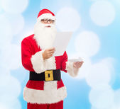 Man in costume of santa claus with letter — Stok fotoğraf
