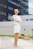 Young smiling businesswoman with crossed arms — Stock Photo