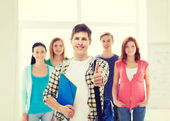 Male student with classmates showing thumbs up — Foto Stock