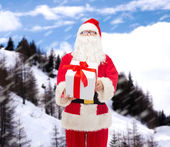 Man in costume of santa claus with gift box — Stock fotografie