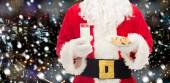 Santa claus with glass of milk and cookies — Stockfoto