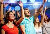 Smiling friends at concert in club — Stock Photo