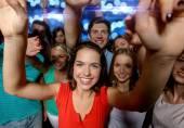 Smiling women dancing in club — Stock Photo