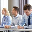 Group of smiling businesspeople meeting in office — Stock Photo #60483171