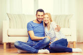 Smiling happy couple at home — Foto de Stock