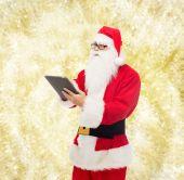 Mann im Kostüm des Weihnachtsmannes mit Tabletpc — Stockfoto