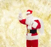 袋的圣诞老人服装的人 — 图库照片