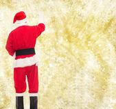 Mann im Kostüm des Weihnachtsmannes, etwas zu schreiben — Stockfoto