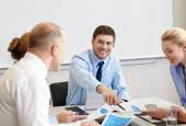 Business people with papers meeting in office — Stockfoto