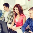 Group of smiling students having discussion — Stock Photo #60563209