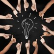 Hands showing thumbs up in circle over bulb symbol — Stock Photo #60565127