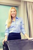 Businesswoman packing things in suitcase — Stock Photo