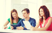 Smiling students with tablet pc at school — Foto de Stock