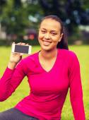 Smiling african american woman with smartphone — Foto de Stock