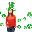 Smiling teen girl in green top hat with shamrock — Stock Photo #60624637