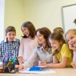 Group of kids with teacher and computer at school — Stock Photo #60625447