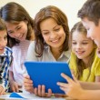 Group of kids with teacher and tablet pc at school — Stock Photo #60625471