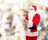 Man in costume of santa claus with notepad — 图库照片