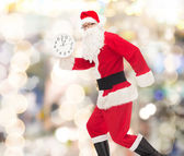 Man in costume of santa claus with clock — Photo