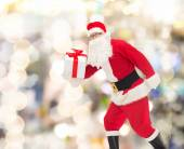Man in costume of santa claus with gift box — Foto de Stock