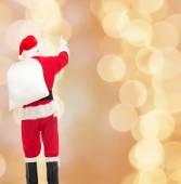 Homme en costume du père Noël avec sac — Photo