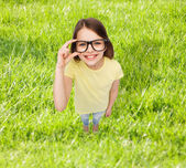 Smiling little girl in black eyeglasses — 图库照片