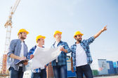 Group of builders with tablet pc and blueprint — Fotografia Stock